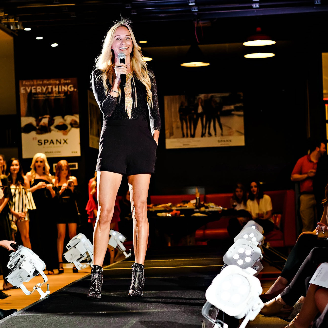 Dana Spinola speaking at a fashion show