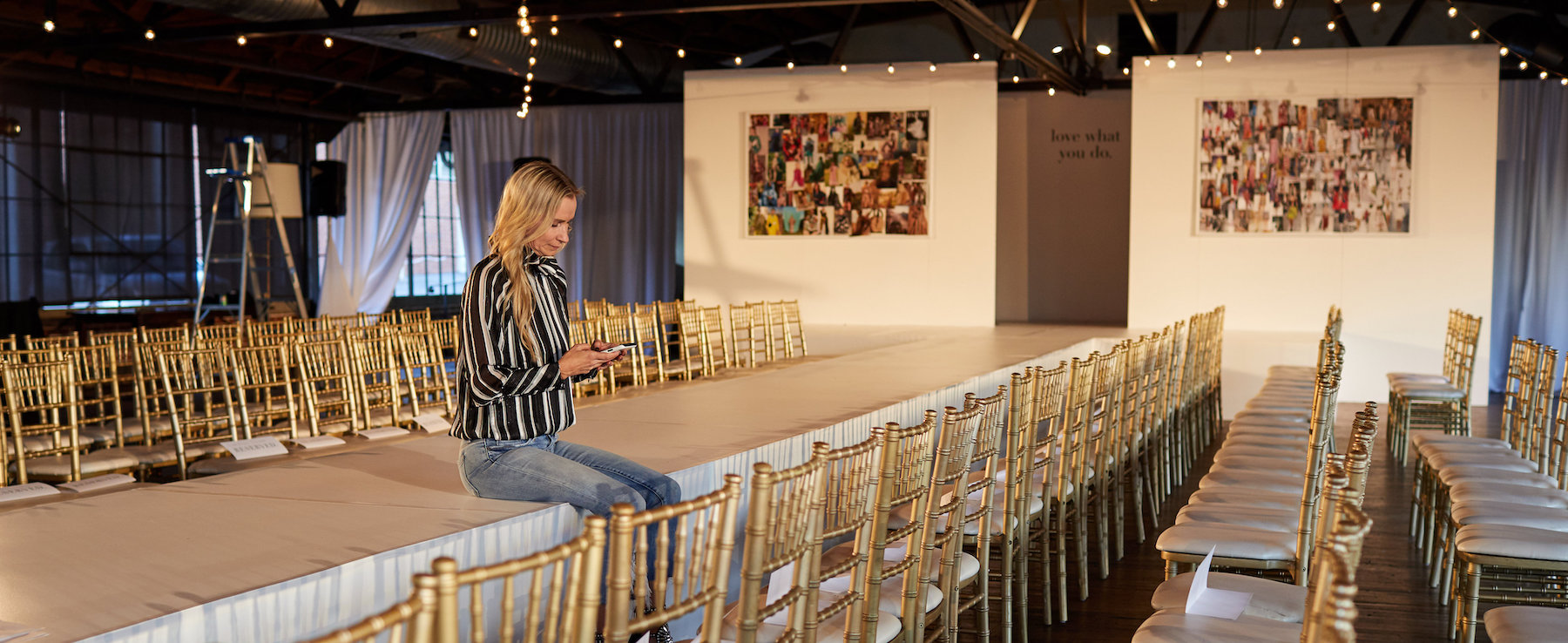 Dana Spinola, sitting on the runway before the fashion show